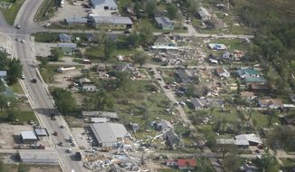 Damage shows the path of tornado through Quapaw, Okla., Monday, April 28, 2014.  The tornado was among a rash of tornadoes and heavy storms that rumbled across the center and south of the country overnight. The National Weather Service warned that more tornadoes, damaging winds and very large hail would strike in parts of Mississippi, Alabama, Tennessee and Louisiana on Monday. (AP Photo/Orlin Wagner)
