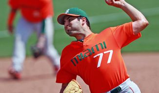 Miami's Bryan Radziewski (77) throws against Clemson during the fifth inning in a college baseball game, Sunday, April 27, 2014, in Clemson, S.C.. (AP Photo/The Independent-Mail, Ken Ruinard) THE GREENVILLE NEWS OUT, SENECA NEWS OUT