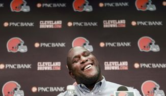 Cleveland Browns general manager Ray Farmer laughs during a news conference at the NFL football team's headquarters in Berea, Ohio, Monday, April 28, 2014. Farmer talked about the upcoming draft as well as confirming the team's interest in two quarterbacks, Vince Young and Tyler Thigpen. (AP Photo/The Plain Dealer, Gus Chan)