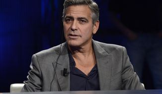 "FILE - This Sunday, Feb. 9, 2014 file photo shows American actor George Clooney interviewed by Fabio Fazio during the Italian State RAI TV program ""Che Tempo che Fa"", in Milan, Italy. Hollywood's most eligible bachelor may be getting hitched. A London law firm on Monday April 28, 2014, has congratulated one of its lawyers on her engagement to George Clooney. (AP Photo/Giuseppe Aresu, File)"