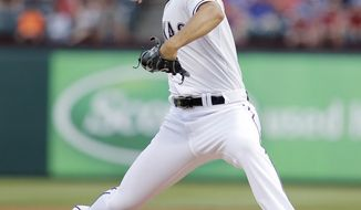 Texas Rangers starting pitcher Yu Darvish (11) throws during the first inning of a baseball game against the Oakland Athletics, Monday, April 28, 2014, in Arlington, Texas. (AP Photo/Brandon Wade)