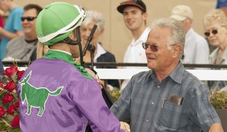 In this image provided by Benoit Photo, trainer Art Sherman, right, celebrates with Alberto Delgado in the winner's circle after California Chrome's victory in the $100,000 Graduation Stakes horse race on Wednesday, July 31, 2013, at Del Mar Thoroughbred Club in Del Mar, Calif. (AP Photo/Benoit Photo) © BENOIT PHOTO