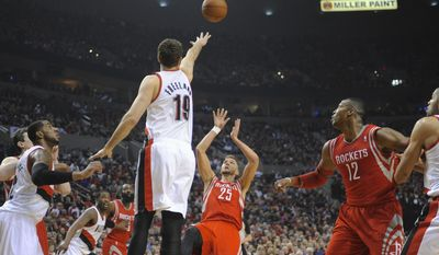Houston Rockets' Chandler Parsons (25) shoots against Portland Trail Blazers' Joel Freeland (19) during the first half of game four of an NBA basketball first-round playoff series game in Portland, Ore., Sunday March 30, 2014. (AP Photo/Greg Wahl-Stephens)