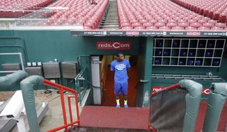 Chicago Cubs left fielder Junior Lake checks the field prior to a baseball game against the Cincinnati Reds that was delayed by rain, Monday, April 28, 2014, in Cincinnati. (AP Photo)