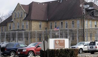 FILE - This Feb. 24, 2012 file photo shows the exterior of the Illinois Youth Center in Joliet, Ill. Efforts to reopen a Joliet youth prison as a facility to treat mentally ill adult inmates have been underway despite claims from Gov. Pat Quinn's administration that extending the temporary income tax increase would be necessary for reopening. Illinois Department of Corrections documents in a story Monday, April 28, 2014, shows the agency is working to reopen the facility and settle a 2007 federal lawsuit claiming the state has failed to address mental illness in a crowded prison system. (AP Photo/Sun-Times Media, Joseph P. Meier, File)  MANDATORY CREDIT, MAGS OUT, NO SALES