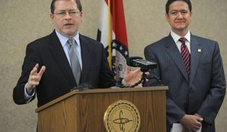 Grover Norquist, left, president of Americans for Tax Reform, speaks Monday, April 28, 2014 in Cape Girardeau, Mo., with Missouri House Speaker Tim Jones at the Cape Girardeau Area Chamber of Commerce. Norquist was appearing at news conferences Monday with Jones in Cape Girardeau and Springfield in support of an income tax cut passed by the Republican-led Legislature. (AP Photo/The Southeast Missourian, Fred Lynch)