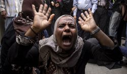 An Egyptian woman screams after a judge sentenced to death 683 alleged supporters of the country's ousted Islamist president over acts of violence and the murder of policemen in the latest mass trial in the southern city of Minya, Egypt, Monday, April 28, 2014. Under the law, Monday's verdicts in Minya have to be referred to Egypt's Grand Mufti, the top Islamic official, said one of the attorneys, Ahmed Hefni. (AP Photo/Roger Anis, El Shorouk Newspaper) EGYPT OUT