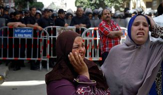 Egyptian women mourn after a judge  sentenced to death 683 alleged supporters of the country's ousted Islamist president over acts of violence and the murder of policemen in the latest mass trial in the southern city of Minya, Egypt, Monday, April 28, 2014. Under the law, Monday's verdicts in Minya have to be referred to Egypt's Grand Mufti, the top Islamic official, said one of the attorneys, Ahmed Hefni. (AP Photo/Ahmed Gomaa)