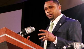 FILE - In this Jan. 31, 2013, file photo, Former NFL football player Troy Vincent speaks during an NFL Player Health and Safety news conference in New Orleans. Vincent is hitting the road in his new job as the NFL's football operations director, meeting with players who have been suspended for on-field incidents. He would not specify which players. Nor did Vincent reveal the identity of other players who are on a league list of those closing in on suspensions for further on-field rules violations. But he's got a clear plan about what he will discuss with them. (AP Photo/Doug Benc, File)