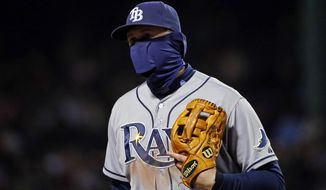Tampa Bay Rays third baseman Evan Longoria has his face covered against the cold during the sixth inning of a baseball game against the Boston Red Sox at Fenway Park in Boston, Tuesday, April 29, 2014. (AP Photo/Elise Amendola)