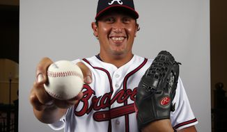 FILE - In this Feb. 24, 2014 file photo, active roster Freddy Garcia of the Atlanta Braves baseball team poses for a photo.  Former All-Star pitcher Garcia has joined Taiwan's EDA Rhinos and is set to become the highest-paid player in the local league's history.(AP Photo/Alex Brandon, File)