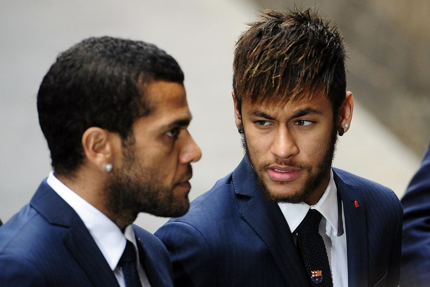 FC Barcelona's Neymar, from Brazil, right, and Daniel Alves, from Brazil, arrive for a religious ceremony at Barcelona Cathedral for late former FC Barcelona's coach Tito Vilanova in Barcelona, Spain, Monday, April 28, 2014. FC Barcelona announced on their web page Friday April 25, 2014, that Vilanova had died Friday following a long battle with throat cancer. He was 45. (AP Photo/Manu Fernandez)