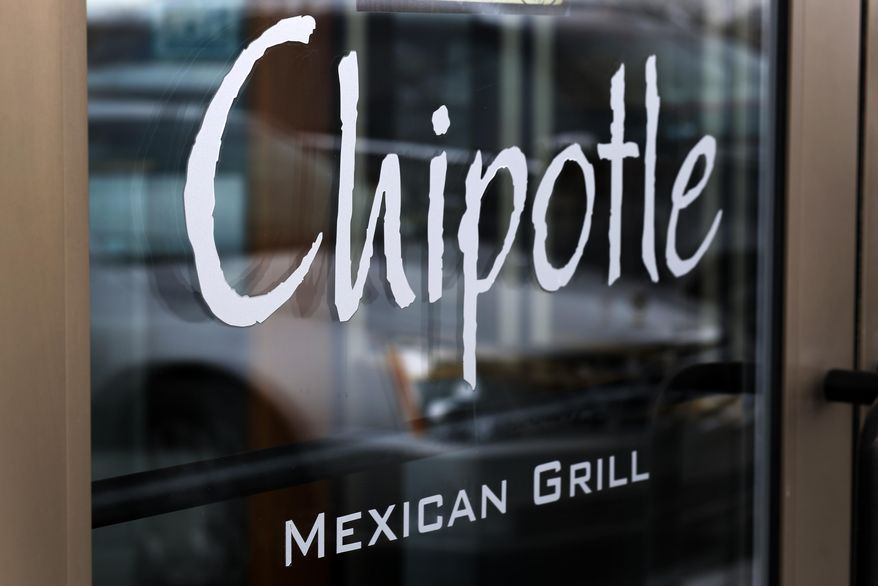 This Tuesday, Jan. 28, 2014, file photo, shows the door at a Chipotle Mexican Grill in Robinson Township, Pa. (AP Photo/Gene J. Puskar, File) ** FILE **