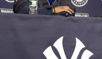 Seattle Mariners' Robinson Cano responds to a question during a news conference before a baseball game against the New York Yankees, Tuesday, April 29, 2014, in New York. (AP Photo/Frank Franklin II)