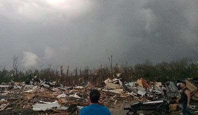 This photo provided by James Bryant shows tornado damage, Sunday, April 27, 2014, in Mayflower, Ark. A powerful storm system rumbled through the central and southern United States on Sunday, spawning several tornadoes, including one  in a small northeastern Oklahoma city and another that carved a path of destruction through several northern suburbs of Little Rock, Ark. (AP Photo/Courtesy of James Bryant) MANDATORY CREDIT