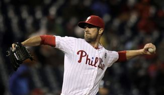Philadelphia Phillies starting pitcher Cole Hamels throws against the New York Mets in the first inning of a baseball game Tuesday, April 29, 2014, in Philadelphia. (AP Photo/H. Rumph Jr)