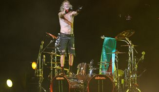 FILE- In this Thursday, Sept. 16, 2010, file photo, James Kottak, drummer of the German rock band Scorpions, gestures during the band's farewell tour in La Paz, Bolivia. Newspapers in the United Arab Emirates are reporting that the American drummer for the rock band Scorpions has been sentenced to one month in jail after being convicted of offensive behavior in Dubai. The government-backed National newspaper reported Tuesday, April 29, 2014,  that James Kottak was convicted of insulting Islam, raising his middle finger, and being under the influence of alcohol while in transit at Dubai airport. (AP Photo/Juan Karita, File)
