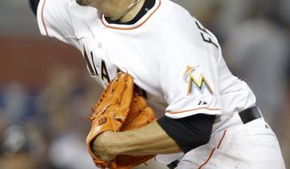 Miami Marlins starting pitcher Jose Fernandez throws during the first inning of a baseball game against the Atlanta Braves, Tuesday, April 29, 2014, in Miami. (AP Photo)