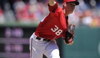 Washington Nationals starting pitcher Taylor Jordan delivers against the San Diego Padres during the first inning of a baseball game on Sunday, April 27, 2014, in Washington. (AP Photo/Nick Wass)