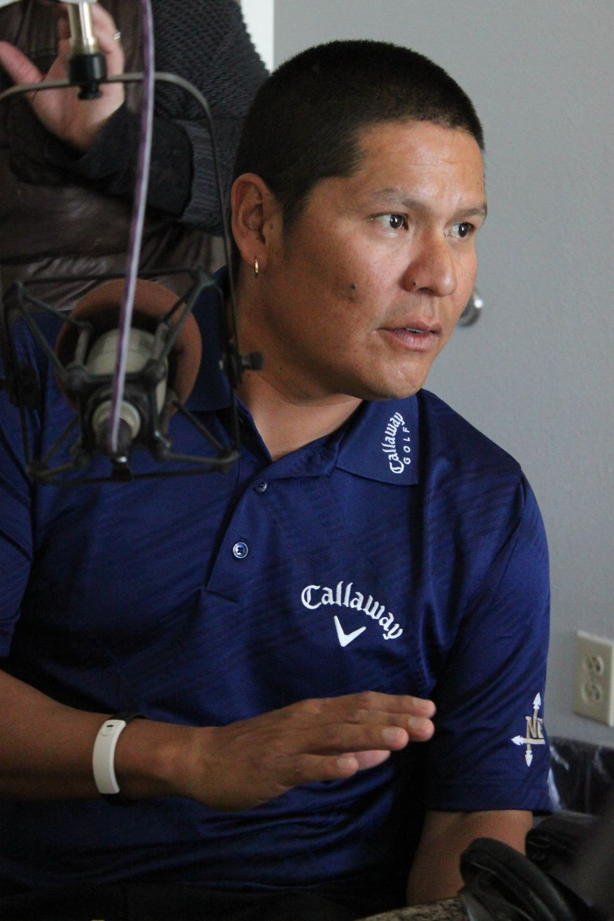 Professional golfer Notah Begay III talks to students before the radio program Native America Calling at a studio in Albuquerque, N.M., on Friday, April 29, 2011. Begay spent much of Friday on the radio and television talking about his mission to combat diabetes among Native American youth. (AP Photo/Susan Montoya Bryan)