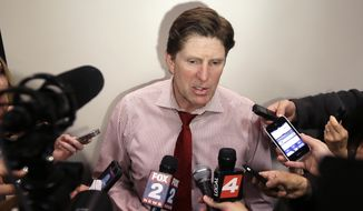 Detroit Red Wings head coach Mike Babcock addresses the media at Joe Louis Arena in Detroit, Tuesday, April 29, 2014. Babcock has one year left on his contract, and signing him to a longer-term deal might be an item on the franchise's list of things to do this offseason. (AP Photo/Carlos Osorio)