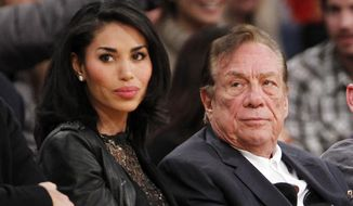 ** FILE ** In this Dec. 19, 2010, file photo, Los Angeles Clippers owner Donald Sterling, right, and V. Stiviano, left, watch the Clippers play the Los Angeles Lakers during an NBA preseason basketball game in Los Angeles. (AP Photo/Danny Moloshok, File)