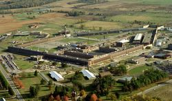 FILE- In a Sept. 22, 2006 file photo, the Southern Michigan Correctionanal Facility in the Jackson, Mich., area is shown. A portion of the former prison is becoming a home for history. The Ella Sharp Museum of Art and History is partnering with the Michigan Department of Corrections to create a prison museum within the 7 Block portion of the prison that closed in 2007, the Jackson Citizen Patriot reported, Tuesday, April 29, 2014. (AP Photo/Jackson Citizen Patriot, Bob Keyes)
