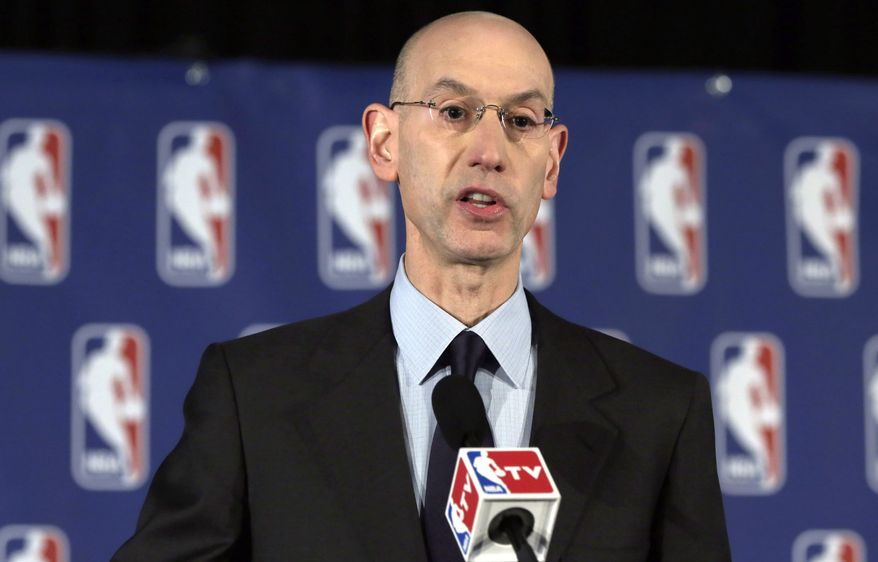 NBA Commissioner Adam Silver reads a statement during a news conference, in New York, Tuesday, April 29, 2014. Silver announced that he is banning Los Angeles Clipper owner Donald Sterling for life from the Clippers organization, in response to racist comments the league says he made in an audio recording. (AP Photo/Richard Drew)