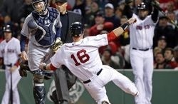Boston Red Sox's Will Middlebrooks (16) slides safely into home on a sacrifice fly by Shane Victorino as Tampa Bay Rays catcher Ryan Hanigan watches during the fifth inning of a baseball game at Fenway Park in Boston, Tuesday, April 29, 2014. (AP Photo/Elise Amendola)