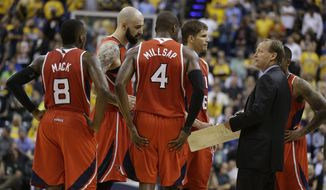 Atlanta Hawks head coach Mike Budenholzer talks to his team during the second half in Game 5 of an opening-round NBA basketball playoff series against the Indiana Pacers Monday, April 28, 2014, in Indianapolis. Atlanta defeated Indiana 107-97. (AP Photo/Darron Cummings)