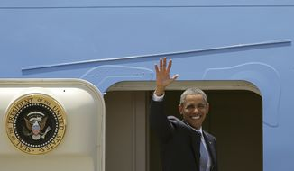 ** FILE ** President Barack Obama waves as he boards Air Force One during his departure at the Ninoy Aquino International Airport in Manila, Philippines on Tuesday, April 29, 2014. (AP Photo/Aaron Favila)