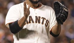 San Francisco Giants relief pitcher Yusmeiro Petit reacts after San Diego Padres' Cameron Maybin grounded out to end the sixth inning of a baseball game Tuesday, April 29, 2014, in San Francisco. (AP Photo/Eric Risberg)