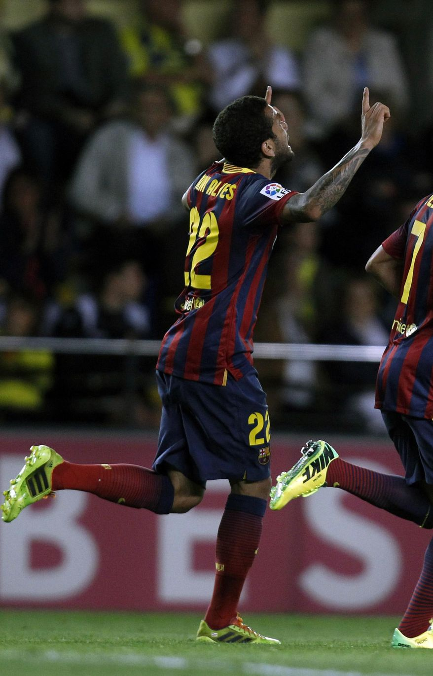 Barcelona's  Daniel Alves from Brazil celebrates after scoring against Villarreal during a Spanish La Liga soccer match at the Madrigal stadium in Villarreal, Spain, on Sunday, April 27, 2014. (AP Photo/Alberto Saiz)