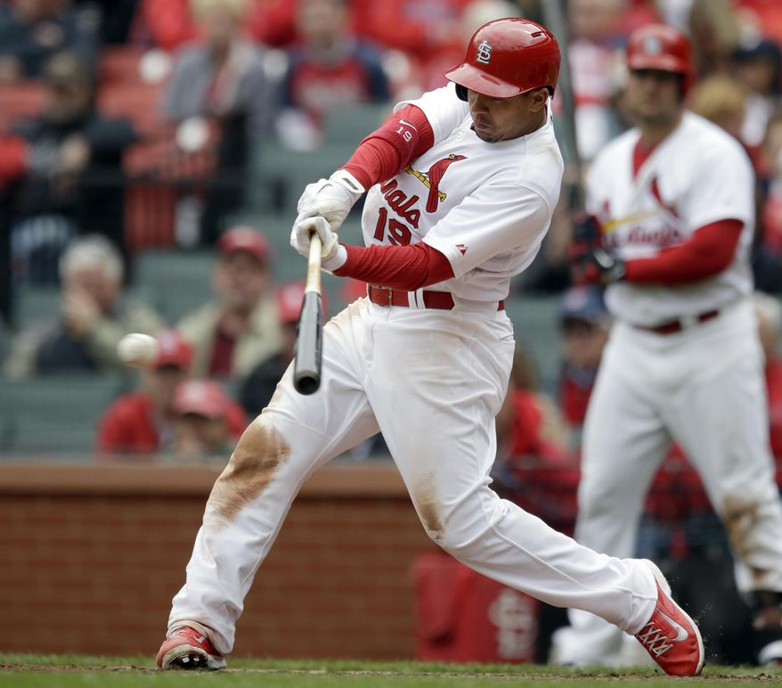 St. Louis Cardinals' Jon Jay hits an RBI double during the fifth inning of a baseball game against the Milwaukee Brewers Wednesday, April 30, 2014, in St. Louis. (AP Photo/Jeff Roberson)