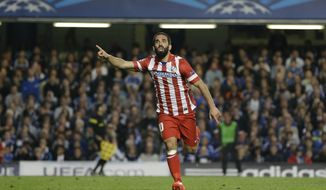 Atletico's Arda Turan celebrates after scoring his soda's 3rd goal during the Champions League semifinal second leg soccer match between Chelsea and Atletico Madrid at Stamford Bridge Stadium in London Wednesday, April 30, 2014. (AP Photo/Kirsty Wigglesworth)