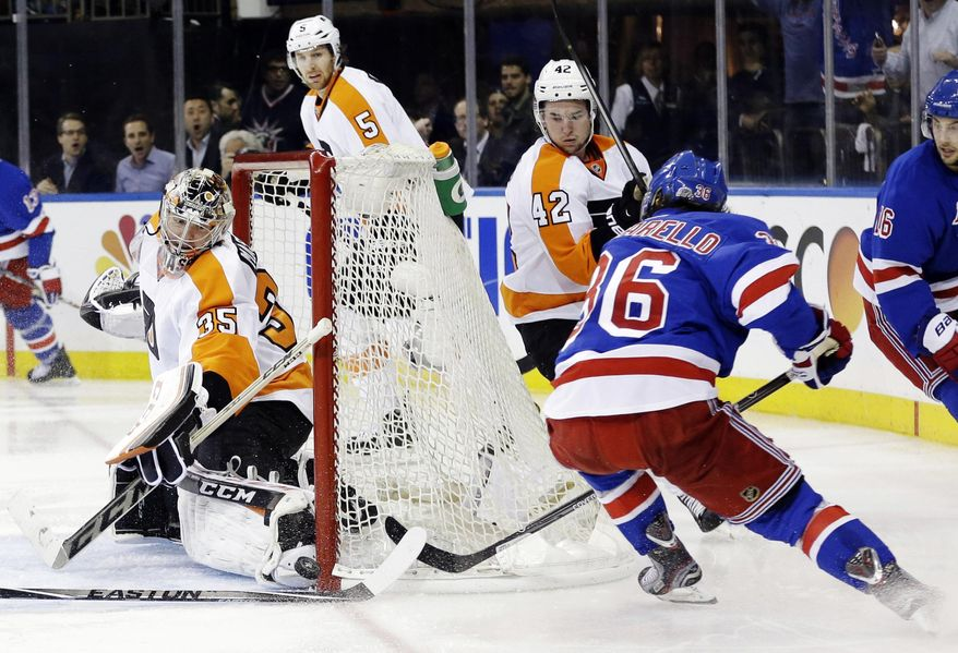Philadelphia Flyers goalie Steve Mason (35) stops a shot on goal by New York Rangers' Mats Zuccarello (36) during the second period in Game 7 of an NHL hockey first-round playoff series on Wednesday, April 30, 2014, in New York. (AP Photo)