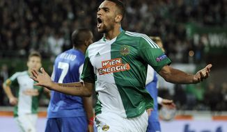 FILE - In this Nov. 7, 2013, file photo, Rapid Vienna's Terrence Boyd celebrates after scoring during the Europa League group G soccer match against Belgian club  KRC Genk, in Vienna, Austria. While fans of the U.S. national team wait to see if Jozy Altidore can find his missing scoring touch for Sunderland in the final weeks of the Premier League, coach Jurgen Klinsmann has noticed another American striker heating up in Austria. Boyd scored two more goals last weekend for Rapid Vienna, netting both in a 2-1 win over league champion Red Bull Salzburg. That followed his two-goal performance a week earlier. (AP Photo/Hans Punz, File)
