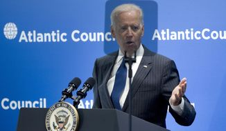 Vice President Joe Biden is seen behind a teleprompter as speaks at the Atlantic Council's conference, in a special tribute to NATO and the European Union, Wednesday, April 30, 2014, in Washington. Biden drew parallels between Russia's interference in Ukraine and the world wars of the last century. Biden said Ukraine's struggles start with Russia's acute violation of rules that the 20th century taught us must be upheld. He says Russia has violated the fundamental principle that Europe's borders cannot be changed by military force. (AP Photo/Jose Luis Magana)