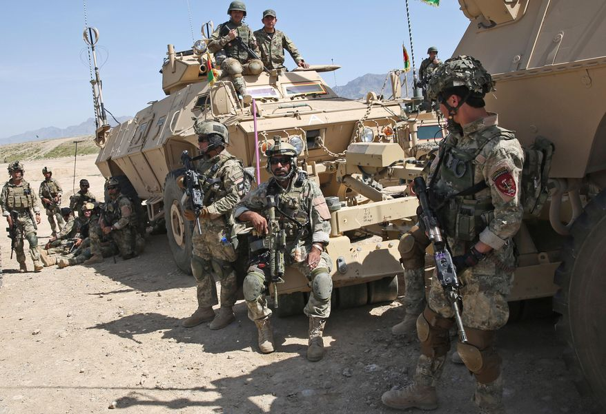 Afghan National Army (ANA) soldiers prepare to participate in a military exercise on the outskirts of Kabul, Afghanistan, Wednesday, April 30, 2014. The Afghan National Security Forces depend exclusively on billions of dollars in funding from the United States and its allies, money that is now at risk. (AP Photo/Massoud Hossaini)