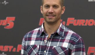 "FILE - In this April 29, 2011 file photo, actor Paul Walker poses during the photo call of the movie ""Fast and Furious 5,"" in Rome. Los Angeles Superior Court Commissioner David J. Cowan appointed an attorney to represent the interests of Walker's 15-year-old daughter Meadow Rain Walker during a hearing on Wednesday, April 30, 2014.  (AP Photo/Andrew Medichini, File)"
