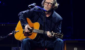 "FILE - In this Feb. 18, 2010 file photo, Eric Clapton performs in concert at Madison Square Garden in New York. Clapton is paying tribute to his late friend and collaborator J.J. Cale with a new album.  Tom Petty, Willie Nelson, John Mayer and others lend a hand on ""The Breeze: An Appreciation of J.J. Cale,"" due out July 29. The album includes 16 Cale songs reimagined by Clapton and the all-star group of friends. Cale, architect of the Tulsa Sound and a widely influential figure in rock 'n' roll history, died last year at 74. (AP Photo/Evan Agostini)"
