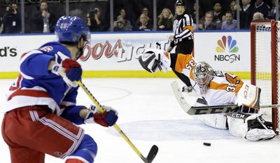 Philadelphia Flyers goalie Steve Mason (35) stops a shot on goal by New York Rangers' Martin St. Louis (26) during the second period in Game 7 of an NHL hockey first-round playoff series on Wednesday, April 30, 2014, in New York. (AP Photo)