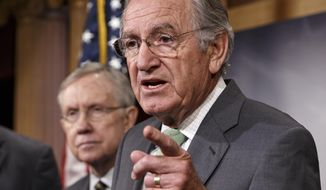 Sen. Tom Harkin, D-Iowa, sponsor of the Minimum Wage Fairness Act, right, joined by Senate Majority Leader Harry Reid of Nev., comments to reporters after the bill to raise the minimum wage to $10.10 was stopped in the Senate, Wednesday, April 30, 2014, during a news conference on Capitol Hill in Washington. Senate Republicans blocked the election-year Democratic bill, handing a defeat to President Barack Obama on a vote that is sure to reverberate in this year's congressional contests. (AP Photo)
