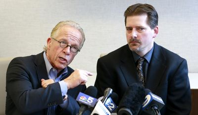 Attorney Jeff Anderson, left, talks about the courage of coming forward by priest sex abuse victim Dave Rudofsky, right, after the release of sex abuse documents from the Diocese of Joliet, Ill., during a news conference Wednesday, April 30, 2014, in Chicago. Anderson spoke to reporters Wednesday as his law firm released documents on 16 priests over several decades. (AP Photo/Charles Rex Arbogast)