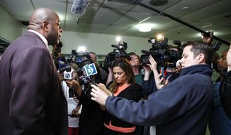 Former NBA star Magic Johnson speaks during a news conference in Saginaw, Mich., Tuesday, April 29, 2014. Johnson answered questions about Los Angeles Clippers owner Donald Sterling, whom NBA Commissioner Adam Silver banned for life from the league. (AP Photo/The Saginaw News, Neil Barris)