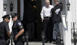 "In this May 5, 2013 photo, funeral director Peter Stefan, second from right speaks to a man on the steps of his Graham, Putnam & Mahoney funeral home, in Worcester, Mass., while handling funeral arrangements for a suspect in the Boston Marathon bombing. Stefan said he was besieged by criticism, picketers and angry phone calls from people who called him a ""traitor"" and ""un-American. A year later, he is writing a book about his experience. (AP Photo/Steven Senne)"
