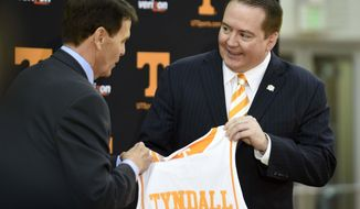 FILE - In this April 22, 2014, file photo, Donnie Tyndall, right, is introduced as Tennessee men's basketball coach by athletic director Dave Hart during a news conference in Knoxville, Tenn. Hart says he sees plenty of similarities between Tyndall and Volunteers football coach Butch Jones.  (AP Photo/Knoxville News Sentinel, Amy Smotherman Burgess, File)