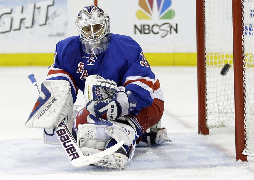New York Rangers goalie Henrik Lundqvist, of Sweden, deflects a shot on goal during the first period against the Philadelphia Flyers in Game 7 of an NHL hockey first-round playoff series on Wednesday, April 30, 2014, in New York. (AP Photo)