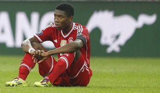 Bayern's David Alaba sits on the pitch after losing the Champions League semifinal second leg soccer match between Bayern Munich and Real Madrid at the Allianz Arena in Munich, southern Germany, Tuesday, April 29, 2014. (AP Photo/Matthias Schrader)