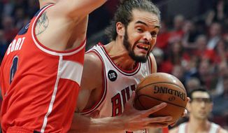 Chicago Bulls center Joakim Noah drives on Washington Wizards center Marcin Gortat during Game 5 of an NBA basketball first-round playoff series, Tuesday, April 29, 2014, in Chicago. The Wizards won 75-69, taking the series. (AP Photo/Daily Herald, Steve Lundy) MANDATORY CREDIT  MAGS OUT